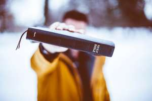 Man holding up Bible